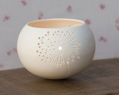 Delecate porcelain Tea light holder with hand carved dandelion design from Wapa Studio. $40 #Pottery #Art