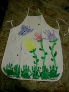 Personalized apron :)  my sons footprints make the butterfly, handprints make the flowers and grass, and thumb prints make bumble bee and lady bugs.  Get a plain apron at Joanns, fabric paint of your choice and some little ones to paint and you are good to go!  Great gift for grandparents or,mothers day!