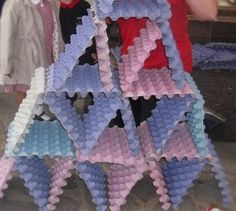 Working together to build triangles at Chadwell Pre-school
