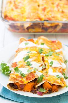You will love this vegetarian take on enchiladas! These Sweet Potato and Black Bean Enchiladas are a spicy, cheesy, and filling meatless ma. I made mine with enchilada sauce instead of salsa Vegetable Enchiladas, Enchiladas Healthy, Vegetarian Enchiladas, Spinach Enchiladas, Vegetarian Main Dishes, Vegetarian Recipes, Cooking Recipes, Healthy Recipes, Vegetarian Mexican