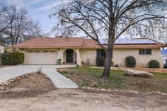 Your Spanish Oasis awaits!!  This 4 BD/1.75 BA split wing home has beautiful arched doorways, laminate flooring, a Fireplace in the family room which is open to the kitchen and dining areas, separate living room with picturesque view windows, updated main bath with a specialized heat retaining bath tub, dual closets in the master suite, an open sunning deck, oak trees, chicken coop, built in deep-pit barbecue and a large usable yard.  Room for your RV and other toys. Solar panels greatly…