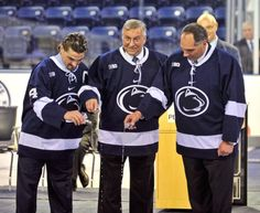 Penn State hockey team captain Tommy Olczyk, left; Buffalo Sabres owner Terry Pegula; and Penn State's Joe Battista pour water onto the ice, signifying the past, the present, and the future of Penn State hockey, during a dedication ceremony for Penn State's Pegula Ice Arena on Friday, Oct. 11, 2013, in State College, Pa. (Nabil K. Mark/Centre Daily Times/AP)