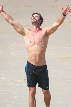 Chris Hemsworth Puts His Glistening Abs on Display in Australia, and We Can't Look Away