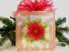 Lighted Glass Block Red Poinsettia Hand Painted 8 x 8 x 3 Christmas. $36.00, via Etsy.