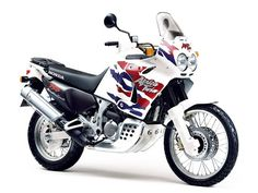 The Honda also known as the Africa Twin, is a 742 cc dual-sport motorcycle manufactured by Honda. The motorcycle was based on the which won the Scooters, Trail Motorcycle, Honda Africa Twin, Pompe A Essence, Motorcycle Manufacturers, Mens Toys, Honda Motorcycles, Motos Honda, Custom Bikes