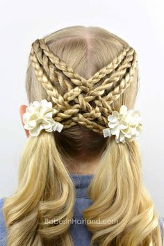 Woven Braids & Twists. Too bad there is no way I'm coordinated enough to do this to my own hair.