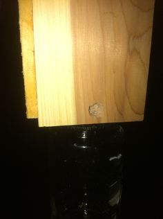 Another view of entry hole.  Carpenter bees really like the scent of cedar, this should do the trick.  Big thing is, when the time comes to empty the jar, should I or shouldn't I?  Lol