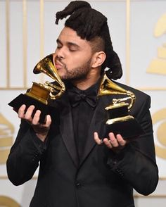 The Weeknd with his two Grammy Awards from tonight: Best R&B Performance for 'Earned It' & Best Urban Contemporary Album for 'Beauty Behind the Madness'. XO