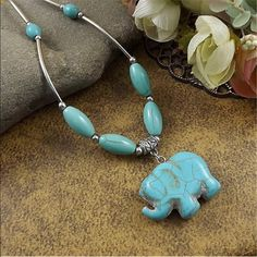ELEPHANT NECKLACE Gorgeous turquoise stone elephant and beads on silver plated NECKLACE. NECKLACE is about 20 inches long Jewelry Necklaces