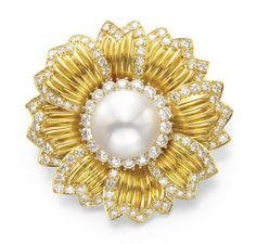A DIAMOND, CULTURED PEARL AND GOLD BROOCH, BY VAN CLEEF & ARPELS Designed as a flower, centering upon a cultured pearl, measuring approximately 15.30 mm, within a circular-cut diamond surround, extending overlapping sculpted gold leaves, with circular-cut diamond trim, mounted in gold Signed Van Cleef & Arpels, N.Y., no. 57927