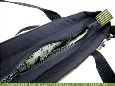 Learn how to make a bag with an inset zipper. Sew4Home