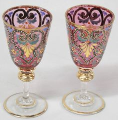"Pair of Moser cranberry sherry glasses with enamel design and floral decorations, circa 1900, 5.25""h"