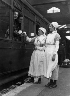Red cross workers serving tea to soldiers, 1914-1918. Female red cross workers serving tea to soldiers on the Great Western Railway, WWI. Women were called to work during the war to replace the men who had gone to Europe to fight. Women worked in many areas such as in munitions factories, on the railways and on the buses. (Photo by Science & Society Picture Library/SSPL/Getty Images)