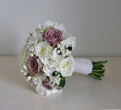 Brides bouquet ...Vintage style bridal bouquet of roses, hydrangea and bouvardia. The bouvardia is perfect for picking up on the lace part of the theme (would suit my dress!).