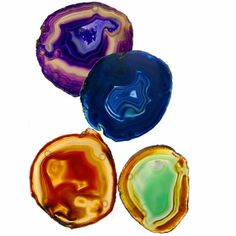 Rablab's Colored Agate Coaster Set. Agate is formed by volcanic activity and found deep in the earth. Many traditions imbue it with magical protective qualities, including the ability to cure the stings of scorpions and the bites of snakes, soothe the mind, prevent contagion, still thunder and lightning, promote eloquence and secure the favor of the powerful.