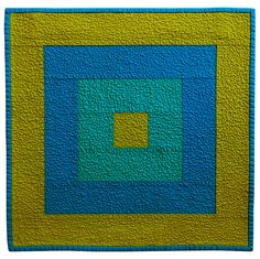 https://flic.kr/p/65paw4 | Mod Square - Functional Art Quilt in Blue and Green | Functional art quilt inspired by mid-century design. Meant to either hang on the wall or displayed on a table. Made from 100% cotton fabrics from Robert Kaufman's Kona collection.  Measures 16.5 x 16.5.