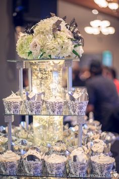 Mirrored wedding cupcake stand. Could do a smaller version with fresh flowers for table centerpieces