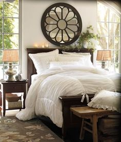 Looks so lovely and inviting. I love how cushy the comforter looks! The mirror is also particularly interesting.