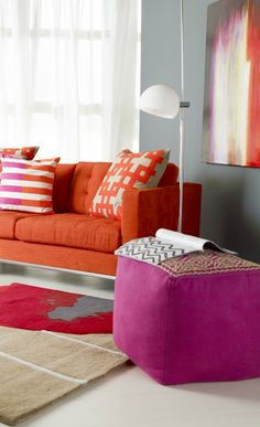 Grey walls need punches of color. Pink, orange and red are great with grey.
