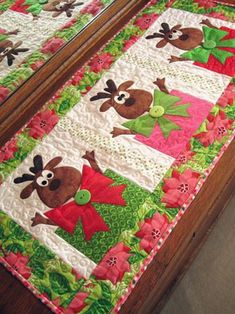 "Fusible applique and simple piecing. Santa recuits his reindeer, there's so much left to do, wrapping gifts and packing the sleigh. Soon it will be Christmas Day! Finished size: 18.5"" x 38"""
