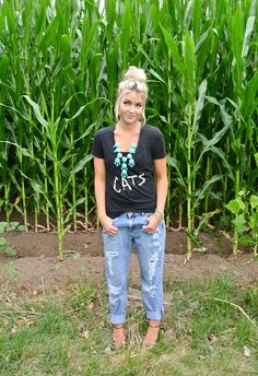 CARA LOREN  necklace: Cheerfully Charmed shirt: Urban Outfitters (sad to say it's old) blazer: Theory  Jeans: Asos  shoes: Steve Madden   glasses: Jessica Simpson {black graphic v neck tee, faded distressed boyfriend jeans, strappy heels, teal statement necklace, messy bun. casual, comfy, school, hangout, spring outfit.}