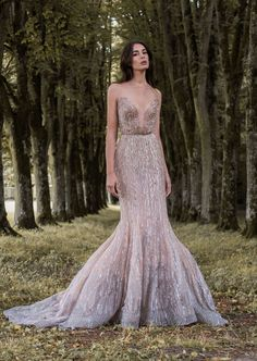 Sexy rose gold and lavender gossamer wing-inspired wedding dress with plunging…