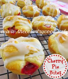 Cherry Pie Bites.  (2 tubes crescent rolls, 1 can cherry pie fillling.  Lay wide side of dough in well of muffin tin. Spoon in pie filling. arrange tails. Bake. Drizzle with powdered sugar glaze.)