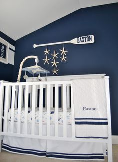 nautical theme nursery.  I love the starfish hanging from the oar