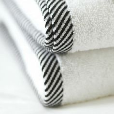 Union Square White Towels - 600 gsm pure cotton  a modern twist on a pure white towel, luxurious 600 gsms white towel with a smart black and white edge.