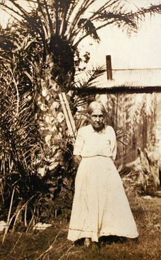 "This portrait of Mary ""Grandma"" Johnson was taken on Mound Key on an unknown date. Grandma Johnson was the matriarch of Mound Key, letting other families live on the island. She taught families how to fish and how to build houses that would survive Florida's severe climate."