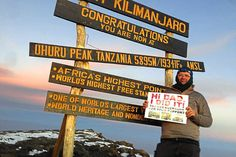 Mike Boyce at the summit of Mount Kilimanjaro in Tanzania, holding a message for his late father Barry #WonderfulWulfrunians