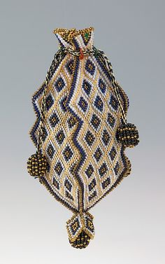 Bag (Reticule)  Date:     1818–30  Culture: Mexican  Medium: glass, silk  Dimensions: 4 3/8 x 1 1/2 in. (11.1 x 3.8 cm)  Credit Line: Brooklyn Museum Costume Collection at The Metropolitan Museum of Art, Gift of the Brooklyn Museum, 2009; Gift of Dwight W. Morrow, Jr., Constance Morrow Morgan, and Anne Morrow Lindbergh, 1956