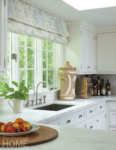 This charming kitchen exudes classic New England style. Interior Design: Nannette Lewis, Architect:  John R. Tankard III