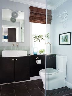 We love the look of this simple-but-elegant bathroom. Click here to find more remodeling tips and tricks: http://www.bhg.com/bathroom/remodeling/makeover/small-guest-bathroom-makeover/?socsrc=bhgpin031415shiningstarbathroom&page=2