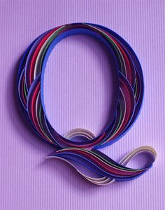 A letter from an alphabet of ornate quilled typography by Sabeena Karnik