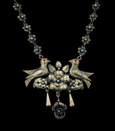 These Victorian style pieces depicting birds were made in Guanajuato and Aguascalientes. The style is known as PAJARITOS. We see the earring pajaritos often but a necklace is a true rarity.