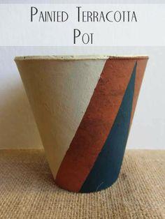 Geometric painted terracotta pot