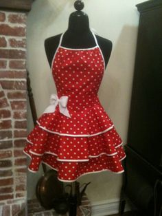 red apron with white polka dots. $40.00, via Etsy.