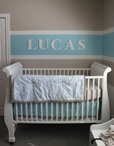 Baby boy nursery room decorated with baby blue brown and cream white horizontal wall paint stripes painting technique