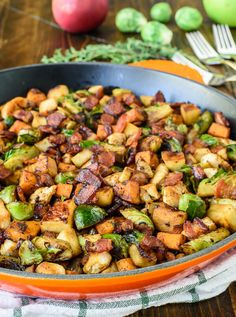 A healthy one-pan dinner your entire family will love! Chicken Bacon Brussels Sprouts Skillet with Sweet Potatoes and Apples