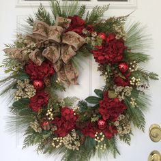 Christmas Wreath-Holiday Wreath-Winter Wreath-Country Christmas-Designer Christmas Wreath-Rustic Wreath-Christmas Hydrangea-Burlap-Christmas    This XL wreath is a classic combination of all the beautiful elements of the holiday season. The natural beauty of long-needled white pine and realistic noble fir combine with myrtle branches and brown eucalyptus to give the feeling of a woodland stroll. Off-white Queen Annes Lace and clusters of elderberries abd natural pine cones set off the…