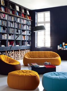 Living Room Design with Fancy and Colored Interior : Big Wall Black Book Shelves With Blue And Orange Couch And Tables