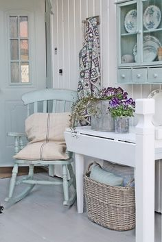shabby chic in white and pale teal ... a lovely corner with rocking chair, desk, basket and cabinet