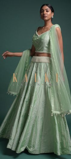 Buy Online from the link below. We ship worldwide (Free Shipping over US$100)  Click Anywhere to Tag Bud-Green-Lehenga-And-Crop-Top-In-Silk-With-Pearls-And-Cut-Dana-Work-Online-Kalki-Fashion