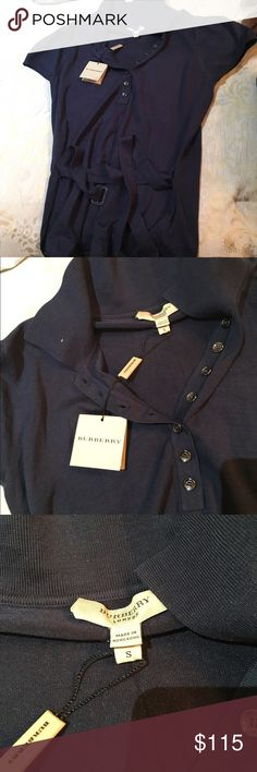 Brand new Burberry top with belt that ties Navy blue cotton Burberry top with cotton belt to tie at the bottom! So cute and very soft! Comes with tags and an extra button attached to the tag inside Burberry Tops