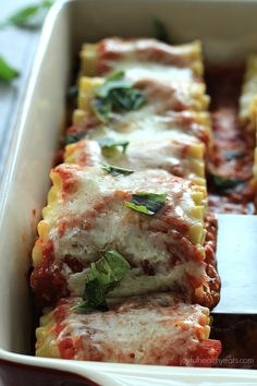 These Skinny Vegetable Lasagna Rolls are the ultimate Italian Food comfort food, packed with fresh vegetables wrapped with noodles and topped with rich tomato sauce and cheese!