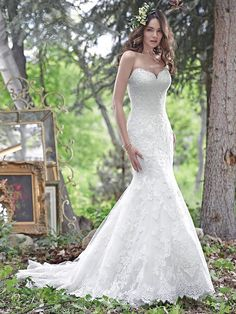 Maggie Sottero - CADENCE, Elegant and timeless, this fit and flare wedding dress features embroidered lace on tulle and a romantic, scalloped lace sweetheart neckline, creating a show-stopping silhouette. Finished with corset closure.