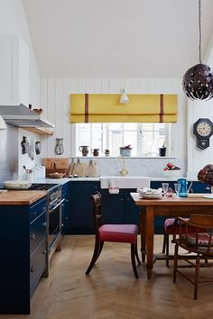 Kitchen in real homes on HOUSE by House & Garden. Inside a Mews House in London: open-plan living made cosy in a tiny west London mews
