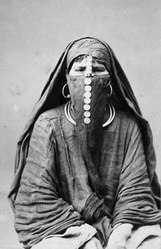 Africa | Veiled woman photographed in Cario, Egypt. ca. 1870s | Photo taken by Délié & Béchard