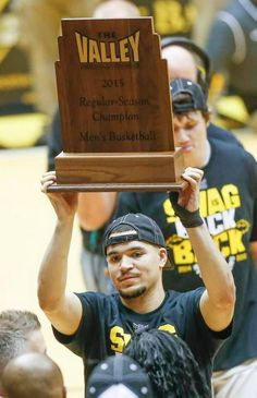 Wichita State guard Fred VanVleet holds up the MVC trophy after the Shockers defeated Northern Iowa on Saturday.